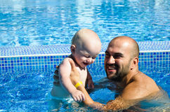 Baby at swimming pool Stock Photos