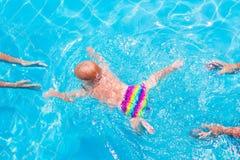 Baby swimming underwater royalty free stock image