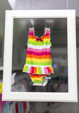 Baby Swimsuit. Colourful baby swimsuit frame display Stock Photos