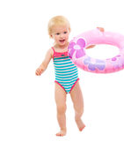 Baby in swimsuit playing with inflatable ring Royalty Free Stock Image
