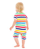 Baby in swimsuit. Rear view Royalty Free Stock Images