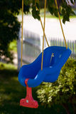 Baby swing 1. Blue and red Baby's swing Stock Image