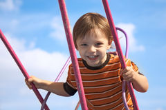 Baby on the swing Stock Photo