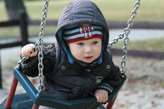 Baby on a swing Royalty Free Stock Image