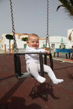 Baby in a swing Stock Photography