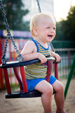 Baby on a swing stock image