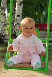 Baby at swing Stock Images