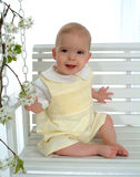 Baby on Swing. Smiling baby boy sitting on swing Royalty Free Stock Images