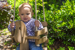 Baby in a swing Royalty Free Stock Photo