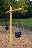 Baby Swing in the Fall Stock Photo