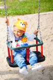 Baby in a swing Stock Photos