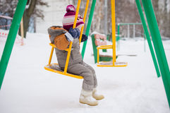 Baby swing on playground Royalty Free Stock Photography