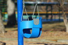 Baby swing at playground Royalty Free Stock Photography