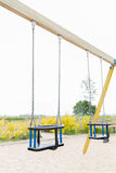 Baby swing on playground outdoors Stock Photos