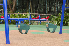 Baby swing set at the playground. The swing is for a young child or baby royalty free stock photo