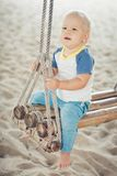 Baby on a swing Stock Photo