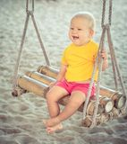 Baby on a swing Royalty Free Stock Photography