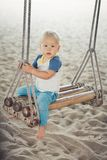 Baby on a swing Stock Photography