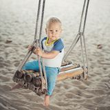 Baby on a swing Stock Photos