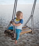 Baby on a swing Royalty Free Stock Images