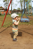 Baby and swing Royalty Free Stock Photography
