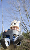 Baby on swing royalty free stock photos