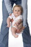 Baby swinging in mothers arms Royalty Free Stock Images