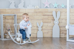 Baby swinging on a rocking chair Stock Photos