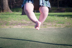 Baby Swinging Stock Images