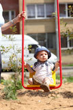Baby swinging on swing Royalty Free Stock Images