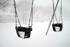 Baby swings covered with snow Stock Photography