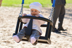 Baby in a swings Stock Image