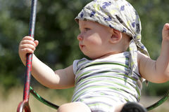 Baby swings at playground Royalty Free Stock Image