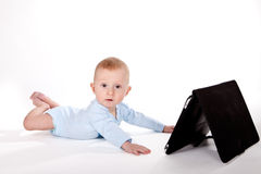 Baby with tablet Stock Photo