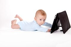 Baby with tablet Royalty Free Stock Photos