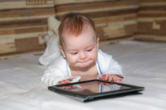 Baby and tablet computer Royalty Free Stock Images