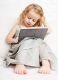 Baby with tablet computer Royalty Free Stock Images