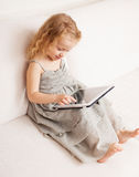 Baby with tablet computer Stock Photography