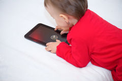 Baby with tablet Stock Photography