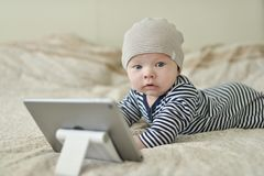 Baby with tablet pc Stock Images