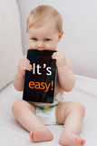 Baby with tablet_txt_Easy Stock Photo