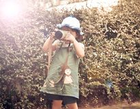Baby take a photo. The girl child Take a photo with digital camera in the garden Royalty Free Stock Photos