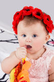 Baby takes thumb in her mouth Stock Photos