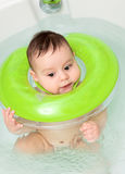 Baby taking a bath Stock Images
