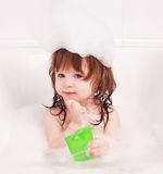 Baby taking a bath Stock Image