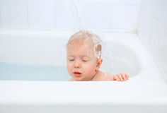Baby taking bath, frozen motion Royalty Free Stock Photo