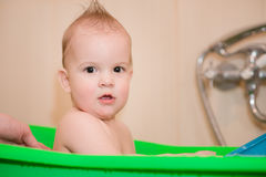 Baby taking a bath before going to bed Stock Photo
