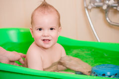 Baby taking a bath before going to bed Stock Images