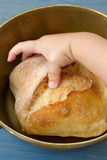 Baby taking bread Stock Photography