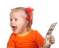 Baby taking dollar banknote. Royalty Free Stock Image